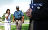 (at left) Cindy Dietz (cq), mother of fallen soldier Danny Dietz (cq) awaits with officer Mike...