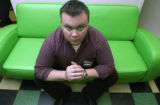 (DENVER, Colo., April 20, 2005) Matt Baldwin, store manager, occupies the fabled couch. The green...