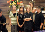 Kaeden Von Duyke (third from left in front) arms folded, joins  his sister Victoria, (left back...