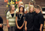 Kaeden Von Duyke (third from left in front) touching his cousin's head,  joins  his sister...
