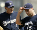 PAGP115 - Milwaukee Brewers manager Ned Yost, left, talks with pitcher Ben Sheets (15) during a...