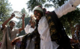 16 year-old Sahra Bashir (cq) from Somalia dances to some East African Music, as fellow Somalians,...
