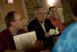 U.S. Senator Wayne Allard (R-Colorado) (center) talks with potential caucus goers, Jason Gordon of...