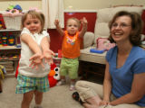 Sophia Zenzinger tries to catch a bubble as does her sister Olivia with great intensity as mom...