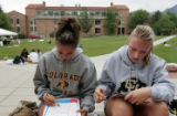 Nicole Sandoval (cq )left, and Auston Hoffman (cq)  both from highlands Ranch wait to register for...