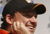 ILWW110 - Tony Stewart smiles at a news conference after winning the NASCAR Nextel Cup USG...