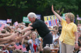 Hillary Clinton, right, campaigns with her husband former President Bill Clinton, left, at a...