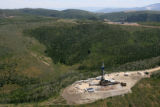 MJM380  Drilling rigs are seen Tuesday July 3, 2007 on the Roan Plateau outside of Rifle, Colo. ...