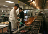 Bob Gitre (cq), left, and Keith Whitmyre (cq), prepare food in the kitchen of Epicurean Culinary...