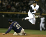 (Denver shot on 4/6/05) Colorado Rockies Aaron Miles jumps out of the way of the San Diego Padres...