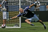 0070 Goalie Kevin Hartman lets one slip by as the Major League Soccer All-Star team practices for...