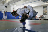 Grace Ohashi, 18, flips teammate Anna Palmer (CQ), 20, during practice at the OLYMPIC TRAINING...
