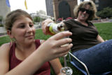 Jennifer Moss Logan (cq) of Denver, right,  pours a glass of sparkling cider for Audrey Logan (cq)...