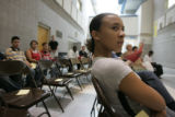 Carolynn Dean (cq), 14, who will be a freshman this year, listens to  questions asked during the...
