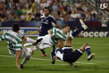 DLM3144  MLS All-Star Ricardo Clark, right, is taken out hard by Celtic defenders Scott Brown,...