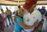 Christina Hinkle, 22, gives her dad, Jim Hinkle (cq both) a giant hug before lunch. Air Force...