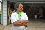 Sandra Trujillo (cq) stands in her Aurora driveway across from the O'Neil home Thursday July...