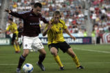 Rapids Midfielder Terry Cooke (11), fights for the ball with Crew Defender Rusty Pierce (4) during...