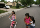 MJM252  Selene Nogueda, 5, left, plays with neighbors, Julie Gonzales, 5, and her sister, Joanna...