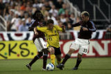 Crew Midfielder Ned Grabavoy (11), fights for the ball with Rapids defenders Ugo Ihemelu (left,...