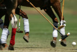 Polo players figth for possession in tthe first match at the 20th Annual Denver Polo Classic,...