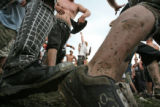 Fans dance at a mosh pit to the music of Authority Zero, a Punk music band from New Mexico at this...
