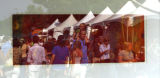 DLM0647  People attending the Cherry Creek Art Festival are reflected in one of artist Lisa...