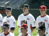 ** SPECIAL FOR THE ROCKY MOUNTAIN NEWS **U.S. team designated hitter Ian Stewart, center, poses...