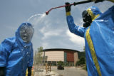 076 SSG. Joe Ziser, right, of the 8th Civil Support Team, Colorado National Guard, decontaminates...