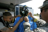 1343 Members of the 8th Civil Support Team, Colorado National Guard, SGT. Larry Sauers, left, and...