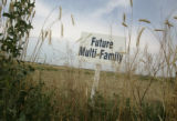 A sign of the future sits in a field of some of the last land to be developed up against E-470...
