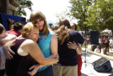 Ellen, left to right, and Traci VanVogelpoel (both cq) embrace during the 3rd Annual GLBT Wedding,...
