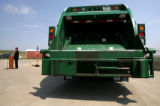 Denver Mayor John Hickenlooper speaks opposite a waste management truck as he speaks at a ground...