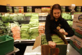 Produce stocker Jean Demo (cq) prepares celery for the shelves in the Wild Oats in Superior,...