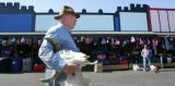 Rusty Morse (cq), of Arvada, carries to his car a bull's skull that he just bought at the Mile...