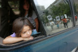 0083 While stopped at a traffic light, Alyah Zaragoza, 5, a United States citizen and the daughter...