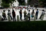 0198 About forty people from the Colorado Immigrant Rights Coalition gathered to protest the...