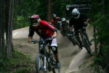 Dennis Kremenetskiy (cq) of Barnaul, Russia, leads a group of four riders around a steep-banked...