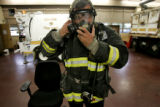 Denver Fire Department Ltd. Butch Hess located at Station 6 Hazmat 1 demonstrates the SCBA (self...