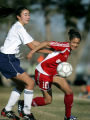(DENVER, CO Shot on 4/7/05)   Mullen's Brittany MacDonald (#5, in white) battles Smoky Hill's...