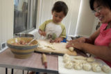 Duran Walters (cq), a native of Mongolia, makes buuz, or beef steamed dumplings and huurshuur,...