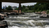 The South Platte River flows north, at Confluence Park, July 13, 2007, Denver. E. Coli levels are...