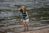 Trysten Klock, 5 years old, enjoys playing along the edge of the South Platte River in Confluence...