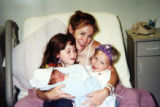 An old  photo of 34 year-old Paige Birgfeld (cq) and her three children, (from left) 8 year-old...