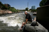 Ken Goodwin (cq), Denver, cools his feet in the South Platte River, July 13, 2007, Confluence...