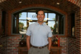 Larry DiPasquale (cq), CEO & Managing Partner,  at the entrance of Epicurean Culinary Group...