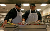 Mitch Cavin (cq), left, Sous Chief, works with Adrian Lyell (cq) while preparing a sallied in the...