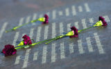 Flowers lay next to a quote at the Columbine Memorial at Clement Park in Littleton, Colo., on...