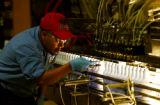 (GREELEY, Colo., Apr. 4, 2005) Rafael Vallejo, production lead, at Loveland Industries adjust...