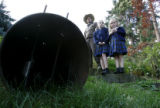 John Newkirk (cq) and his daughters Mandy, 8 center, and Katie,5  stand near a bear trap where the...